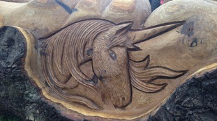 Unicorns adorn the bench, Becky's favourite mythical animal.