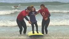 The project uses surfing as therapy to support vulnerable young people.