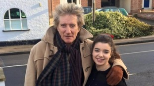 Rod Stewart with staff member Alexandra Conduto.