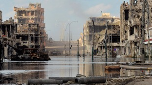 Scenes of devastation after violent clashes between Libyan interim government forces and loyalists of Muammar Gaddafi in Sirte in 2011