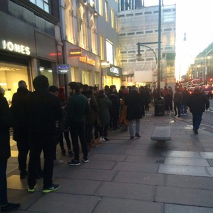 Shoppers queue in the freezing cold Kanye West trainers.