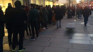 Hundreds of shoppers queue for hours in the freezing cold for Kanye West trainers
