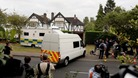 Surrey Police outside the home of Saad Al-Hilli in Claygate on Monday.