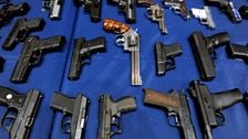 Seized guns on display in New York City in 2013