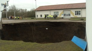 Huge sinkhole swallows parts of buildings in Germany
