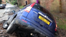 "A car stuck in the burst pipe hole has ""complicated"" repairs"