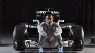 Lewis Hamilton poses in front of the new car.