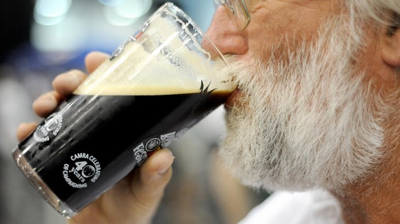 A drinker sups a pint of real ale at last year's Great British Beer Festival