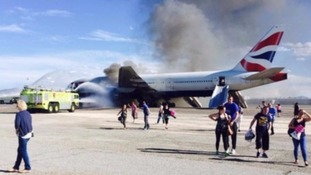 Passengers were forced to evacuate the burning plane on emergency slides.