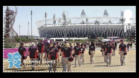 Stamp design with Games Makers in front of the Olympic Stadium.