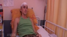 Robbie Hughes in hospital after the attack.