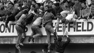 Liverpool fans trying to escape severe overcrowding during the FA Cup semi-final football match against Nottingham Forest at Hillsborough.