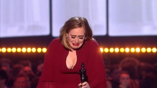 A teary Adele as she won her third night of the evening.