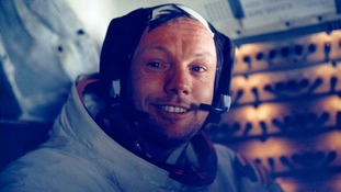 Neil Armstrong smiles in the lunar module after his historic moonwalk
