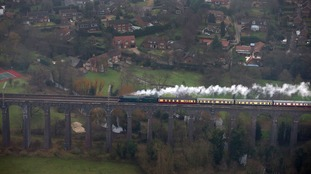 An aerial view of the Flying Scotsman going over the Digswell Viaduct near Welwyn Garden Cit