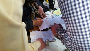Iranians cast their votes in Friday's crucial elections