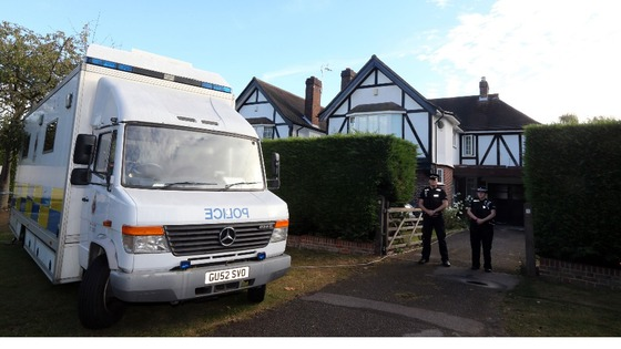 Surrey Police outside the home of Saad Al-Hilli in Claygate, Surrey.