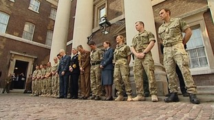 Troops gathered at Admiralty House to receive their honours.
