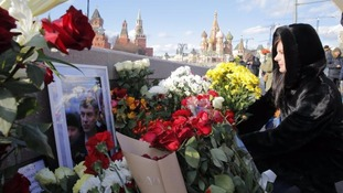 Russians rally to mark year since murder of leading opposition figure Boris Nemtsov