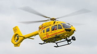 An air ambulance was scrambled to treat the stricken pilot