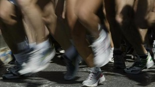 The runner is said to have collapsed less than a mile from the finish line