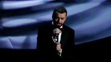 Sam Smith performs Writing's On The Wall at the Oscars.