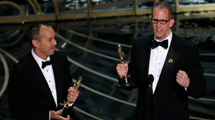 Pete Docter (R) and Jonas Rivera receive the Oscar for Best Animated Feature