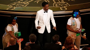 Chris Rock gets the Oscars audience to shell out for some cookies.