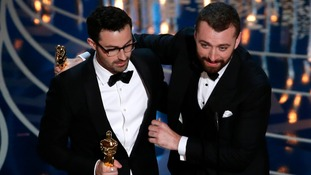 Jimmy Napes and Sam Smith hold their Oscars for Best Original Song.