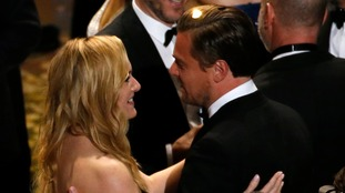 Kate Winslet congratulates Leonardo DiCaprio on his Oscars win.