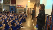 Laura Penhaul speaking at her old school in Redruth