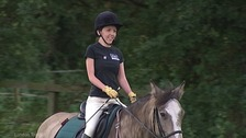 A girl horseriding.