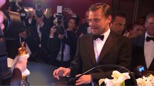 Leonardo DiCaprio waiting for his Oscar to be engraved at the Governors Ball
