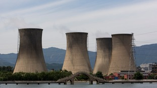 The cooling towers at a Shougang Group steel plant on the outskirts of Beijing, as reports suggest millions of Chinese workers may be laid off in the next three years