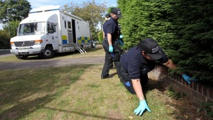 Police search outside the home of Saad al-Halli in Claygate, Surrey.