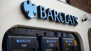 Barclays shares briefly suspended as bank announces drop in profits and dividend cut