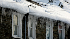 Icicles and snow on roof