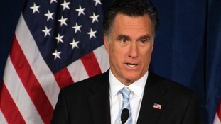 Mitt Romney has dialled down his criticism of the Obama administration over the Libya attacks