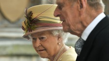 Queen Elizabeth arrives with Prince Philip to address both Houses of Parliament at Westminster Hall in London March 20