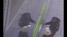 Police want to speak to two men who robbed the 76-year-old at an ATM