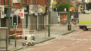 A bomb disposal robot in Belfast's Woodstock Road area, where the car bomb exploded
