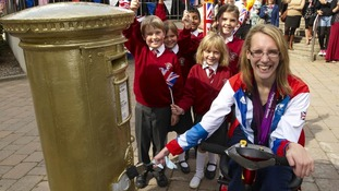 Sophie Christiansen next to gold postbox.