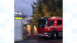 Firefighters tackle the fire