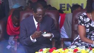 Robert Mugabe tucked into cake at his latest lavish birthday celebrations.