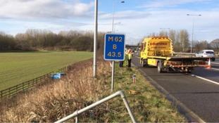 Allegedly drunk driver found asleep in field next to M62