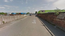 The woman's body was discovered in Sandfold Lane, Gorton.