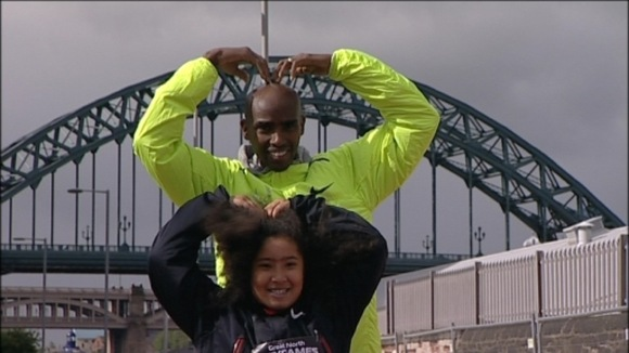 Mo Farah and his daughter doing the famous &#x27;Mo-Bot&#x27; celebration in front of the Tyne Bridge