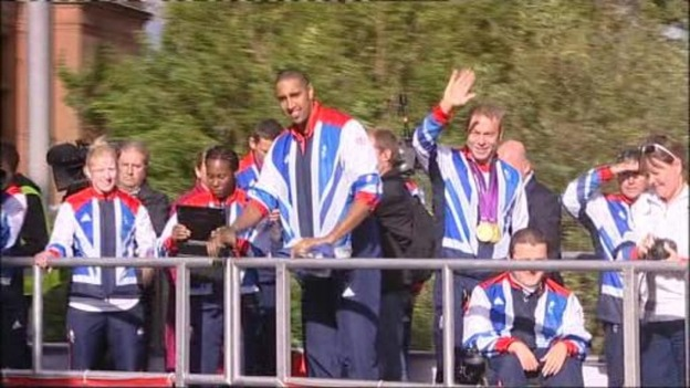 Scottish athletes take part in a parade in Glasgow