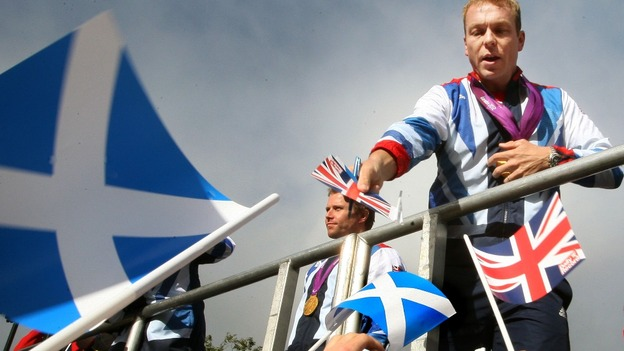 Six-time gold medallist, Sir Chris Hoy signs his autograph during the official victory parade