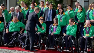 Ireland's Taoiseach Enda Kenny greets members of the Paralympic team
